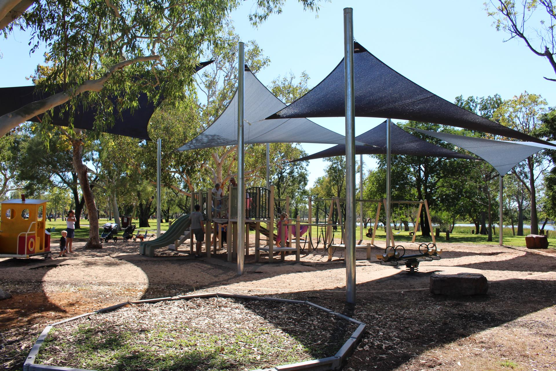 Kids are happy as new shade sails are installed at Celebrity Tree Park