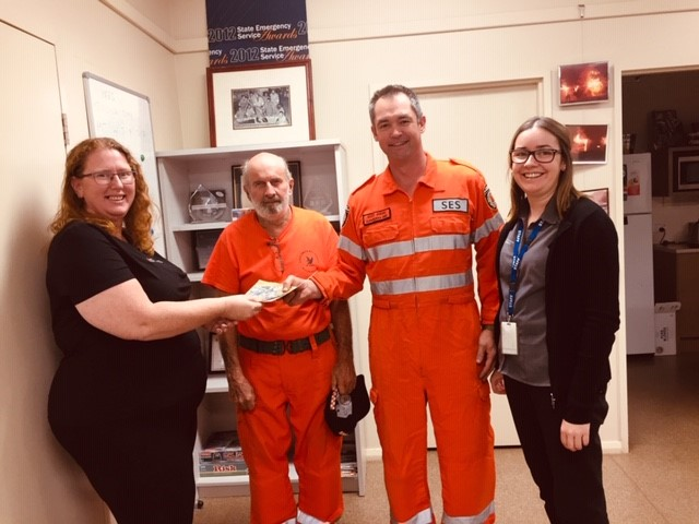 SES volunteers receive SWEK fundraising from WOW day